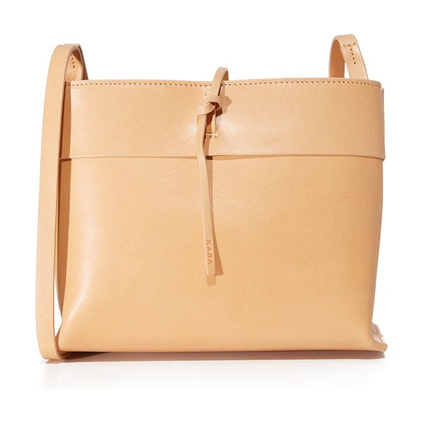Kara tie cross body bag in nude - A streamlined KARA cross-body bag in smooth leather. A...
