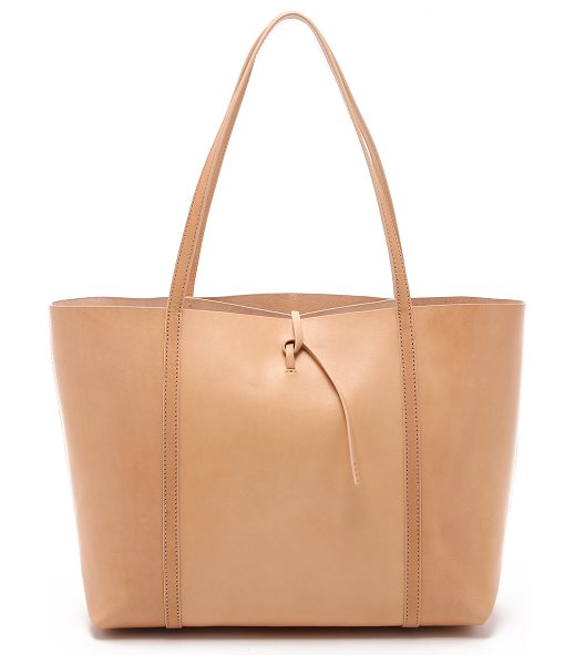 Kara tie tote in nude - A large KARA tote with a minimalist profile. A slim...