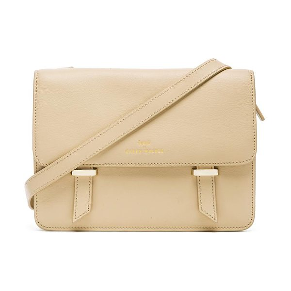 Karen Walker Sloane satchel in cream - Leather exterior with printed fabric lining. Measures...