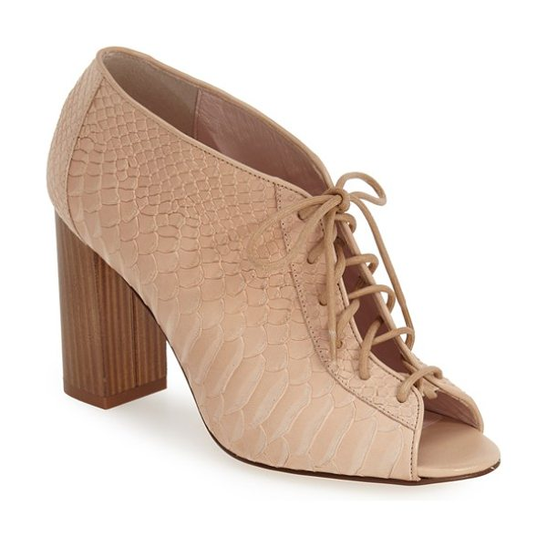 KATE SPADE NEW YORK inella lace-up bootie in desert - Corset-style lacing and a chunky, vertical woodgrain...