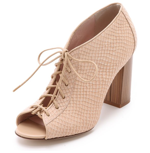 Kate Spade New York Inella lace up booties in desert - A snake embossed upper and chunky wooden heel bring...