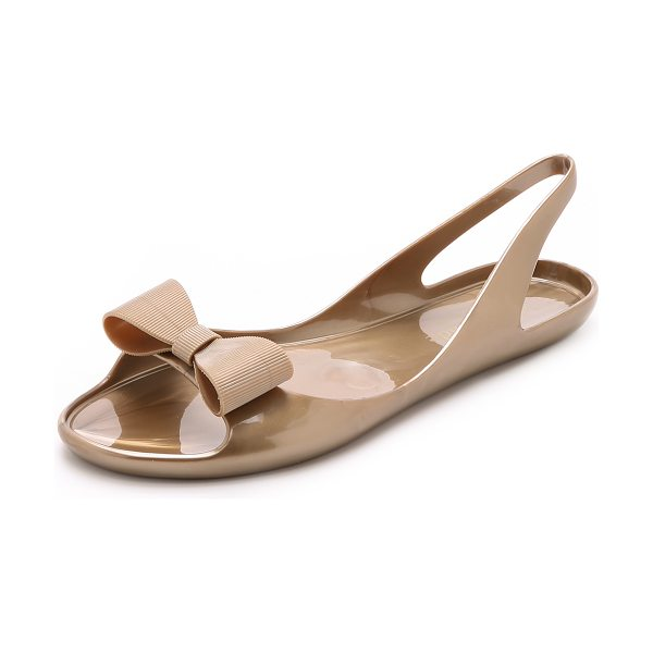 Kate Spade New York Odessa jelly sandals in gold