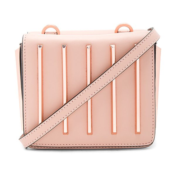 KENDALL + KYLIE Baxter Crossbody Bag in blush - Leather exterior with suede lining. Double flap tops...