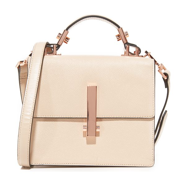 KENDALL + KYLIE mini minato top handle bag in cream tan - Edgy hardware accents this sophisticated KENDALL + KYLIE...