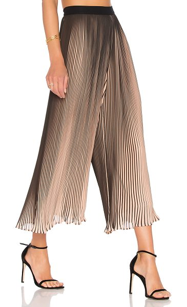 KENDALL + KYLIE Pleated Pant in nude beige & black - Whisked away with a wide leg fit, KENDALL + KYLIE's...