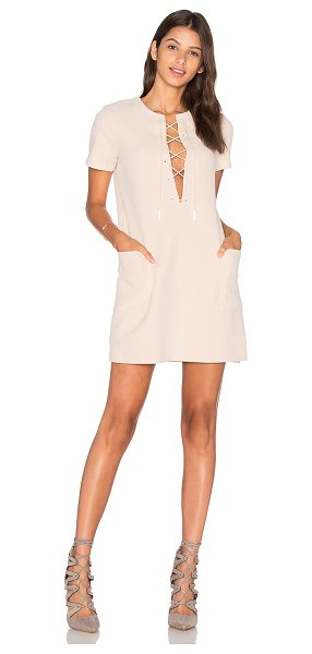 KENDALL + KYLIE Safari Dress in beige - 96% poly 4% spandex. Unlined. Front lace-up tie closure....