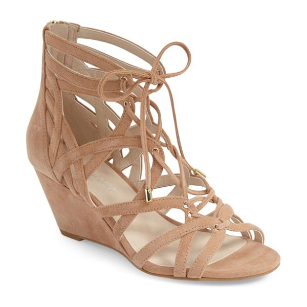KENNETH COLE 'dylan' wedge sandal - A stylish gladiator sandal set on a covered wedge heel...
