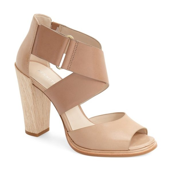 Kenneth Cole 'sora' sandal in beige/ tortora leather - A wood-like block heel lifts a sleek sandal with wide...