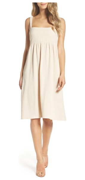 Knot Sisters dress in natural - A cotton knee-length dress with practical pockets is...