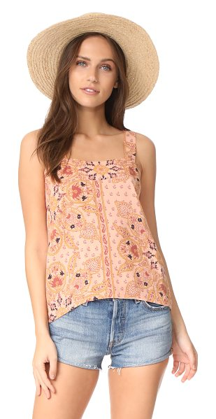 Knot Sisters witness top in blush mandala - A full-length back slit relaxes the fit of this printed...