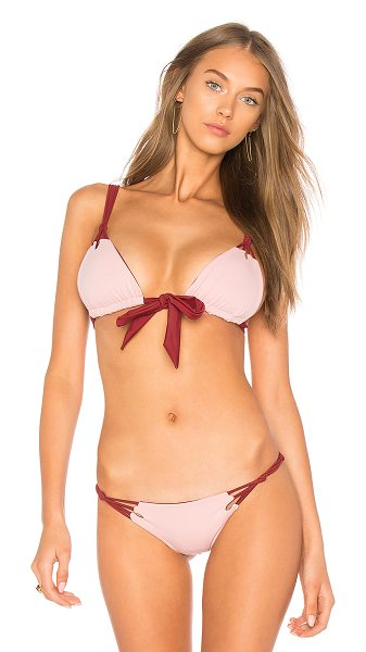 KOA Reversible Daisy Top in narobi & blush - 82% nylon 18% spandex. Hand wash cold. Front tie...