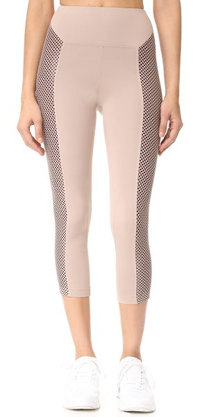 Koral Activewear clementine high rise leggings in bisque - Lined side panels in soft mesh lend unique detail to...