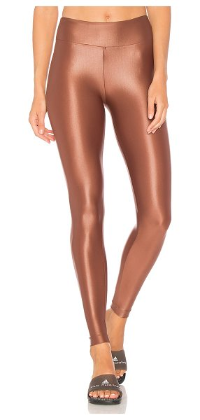 Koral Activewear Lustrous High Rise Legging in metallic copper - 85% polyamide 15% spandex. Stretch fit. Water and...