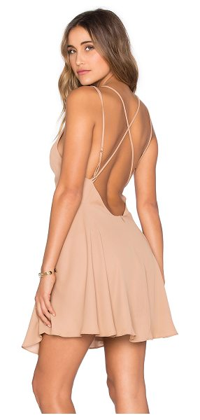 krisa Cross Back Mini Dress in tan - 100% poly. Partially lined. Surplice neckline....