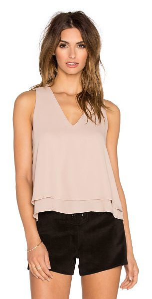 krisa Open back tank in blush - 100% poly. Back keyhole with button closure. Tiered...