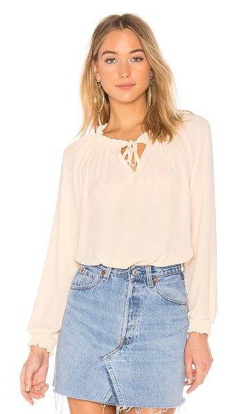 krisa Smocked Blouse in vanilla - 100% poly. Smocked elastic neckline and arm openings....
