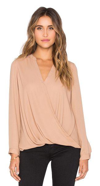 krisa Surplice long sleeve blouse in tan - 100% poly. Surplice neckline. Draped front. KISA-WS130....