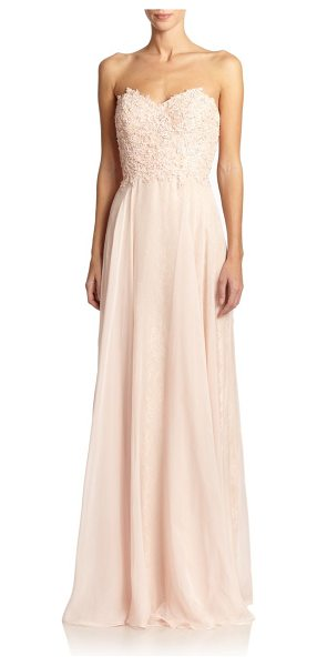 La Femme Lace-top strapless gown in blush - A floral lace bodice dusted with sparkling beads dresses...