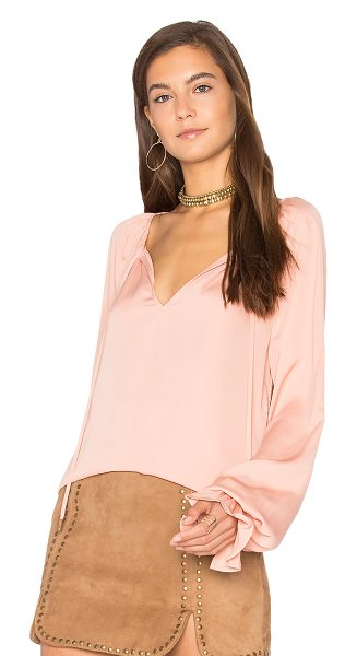 L'ACADEMIE The Boho - Of-the-moment details make the Boho Top by L'Academie a...