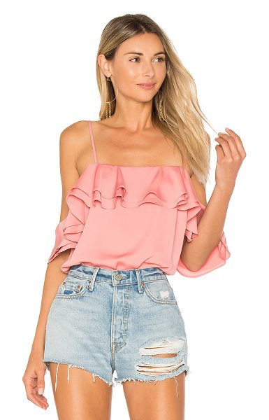 L'Academie The Off Shoulder Bodysuit in pink - Prim and tucked into your favorite denim, The Off...