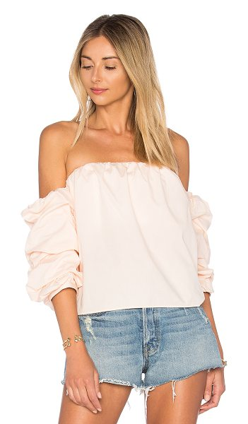 L'Academie x REVOLVE The Puff Sleeve Blouse in pink - Poplin perfection is exemplified in The Puff Sleeve...