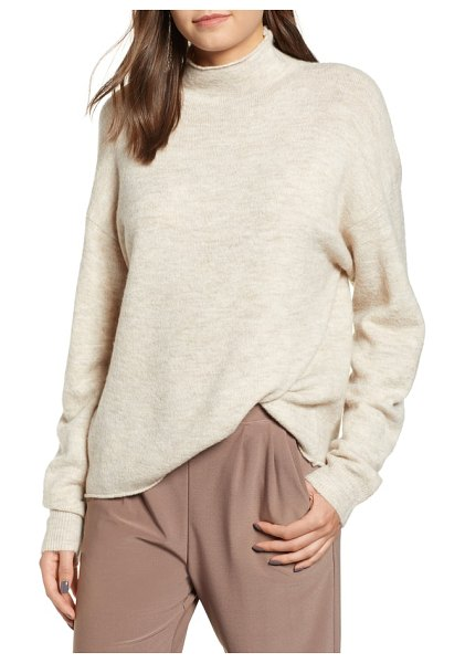 Leith cozy mock neck sweater in beige oatmeal heather - Comfort and sophistication are the name of the game with...