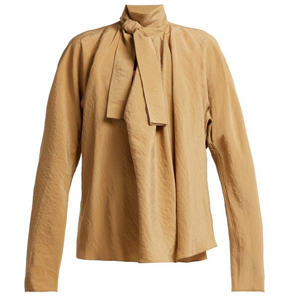 LEMAIRE Draped Pussy Bow Blouse in tan - Lemaire - Volume, function and draping informs Lemaire's...