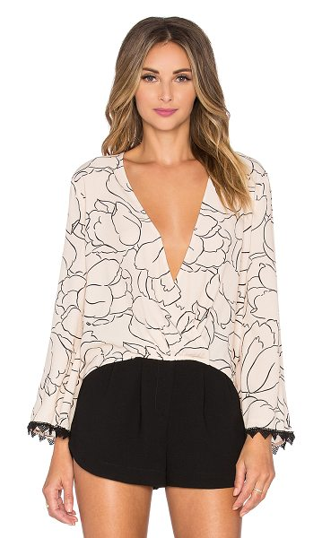 Line & Dot Plein blouse in peach - Poly blend. Wrap front with button closure. Lace trimmed...