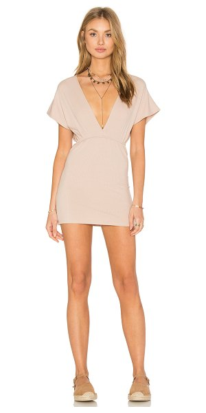 Lisakai Deep V Rib Dress in beige - 65% rayon 30% poly 5% spandex. Unlined. Rib knit fabric....