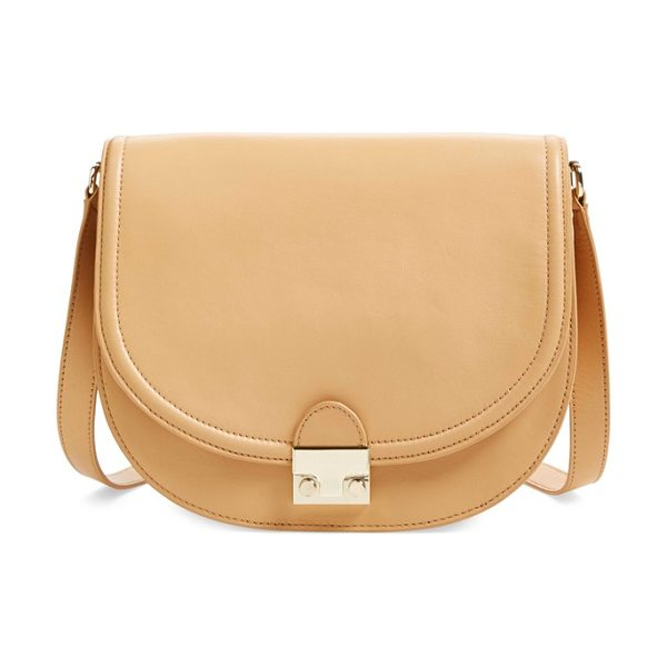 Loeffler Randall 'large' leather saddle bag in natural - A signature push-lock closure secures a structured...