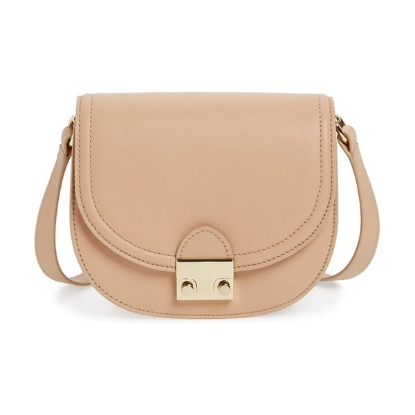Loeffler Randall leather saddle bag in natural - A logo-etched push-lock closure secures a structured...