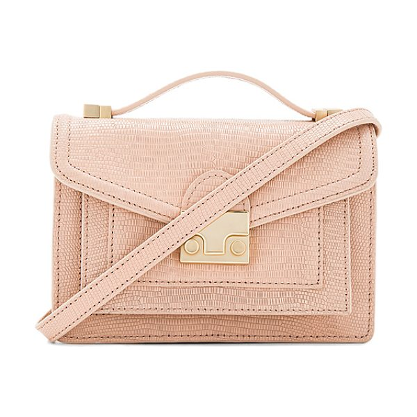 Loeffler Randall Mini Rider in blush - Lizard embossed leather exterior with printed fabric...
