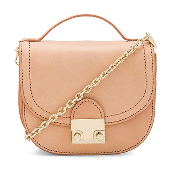 Loeffler Randall Mini Saddle in beige - Leather exterior with printed fabric lining. Flap top...