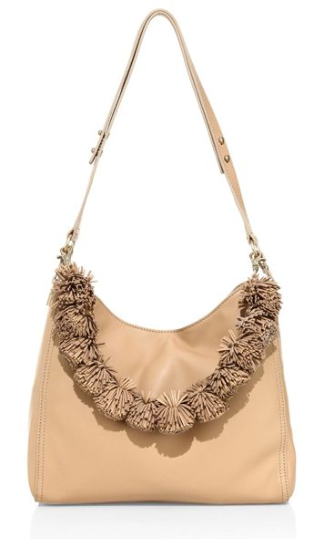 Loeffler Randall mini leather hobo bag in natural - Chic pom-poms define this sheep leather hobo bag....