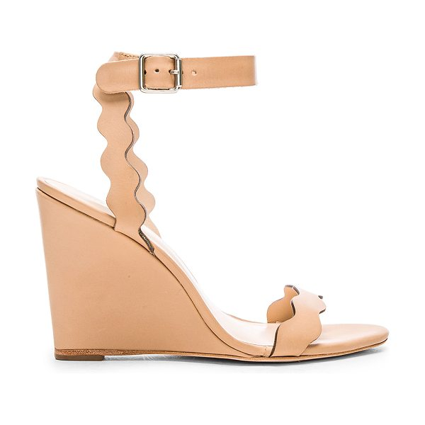 Loeffler Randall Piper wedge in beige - Leather upper and sole. Scalloped edges. Buckle closure....