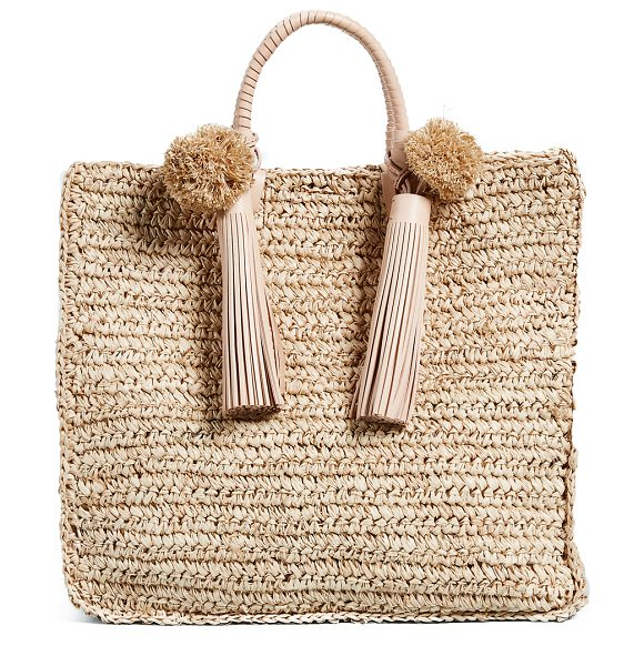 Loeffler Randall straw travel tote in natural/multi stripes - Fabric: Woven straw Pom-pom accents Magnetic closure at...