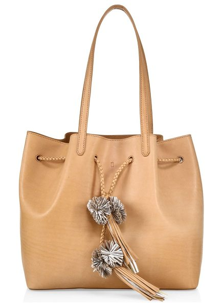 Loeffler Randall vachetta leather drawstring tote in natural - Braided drawstring and tassels style this tote. Double...