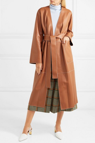 Loewe belted leather coat in tan - When Jonathan Anderson joined Loewe, he started to think...