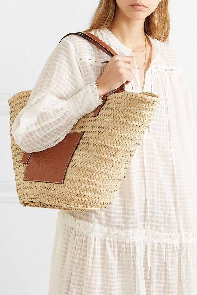 Loewe large leather-trimmed woven raffia tote in tan - Jonathan Anderson basically confirmed that straw bags...