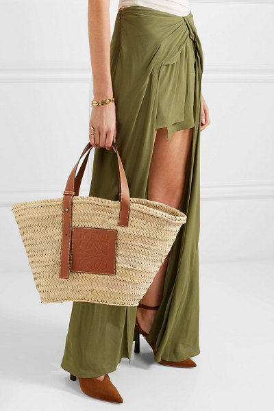 Loewe medium leather-trimmed woven raffia tote in tan - If you still can't get enough of the French-style basket...