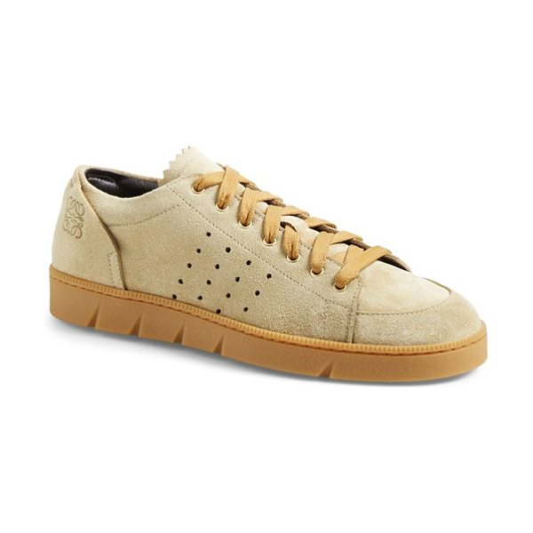 Loewe sneaker in gold - A classic sneaker silhouette is updated with perforated...