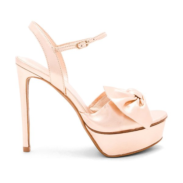 """Lola Cruz Bow Platform Heel in pink - """"Metallic leather upper with leather sole. Ankle strap..."""