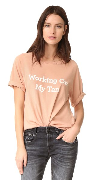 Lolli working on my tan tee in tan - A playful Lolli tee with 'working on my tan' lettering...
