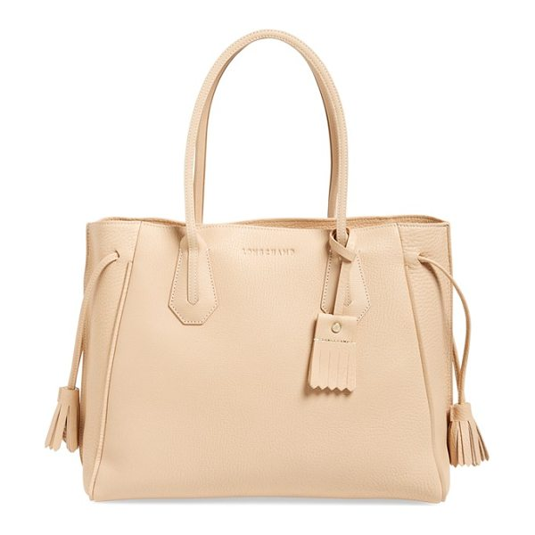 Longchamp Penelope tote in sandy - Born from a fusion of styles and Longchamp know-how, the...