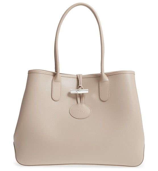 LONGCHAMP roseau leather shoulder tote - A sleek bamboo-shaped metal toggle secures the open top...