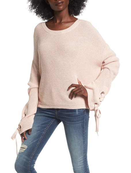Love By Design grommet sleeve pullover in pink adobe as sample - Lace-up ties thread through metal grommets at each...