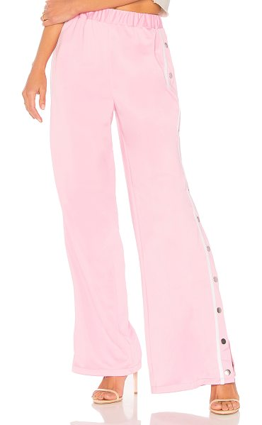 """Lovers + Friends Athletic Snap Track Pant in pink - """"Take on the trend that is athleisure with the Lovers +..."""
