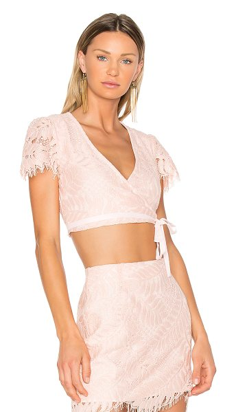 Lovers + Friends It's A Wrap Top in pink - Embrace the romance in elegant lace and blush hues. The...