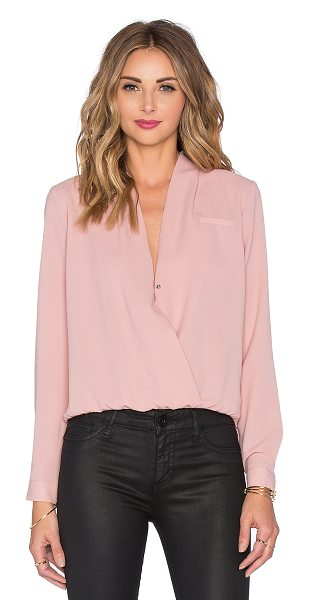 Lovers + Friends x REVOLVE Get Down Blouse in blush - 100% poly. Hand wash cold. Front snap button closure....