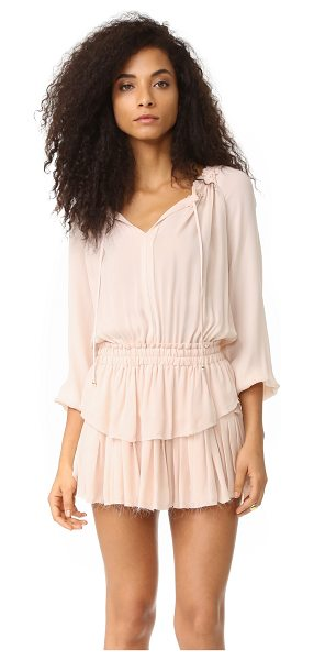 LOVESHACKFANCY Popover dress in powder pink - Soft ruffles and raw edges detail this charming...